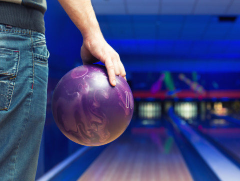 Bowler Holding Ball; Cosmic Bowling
